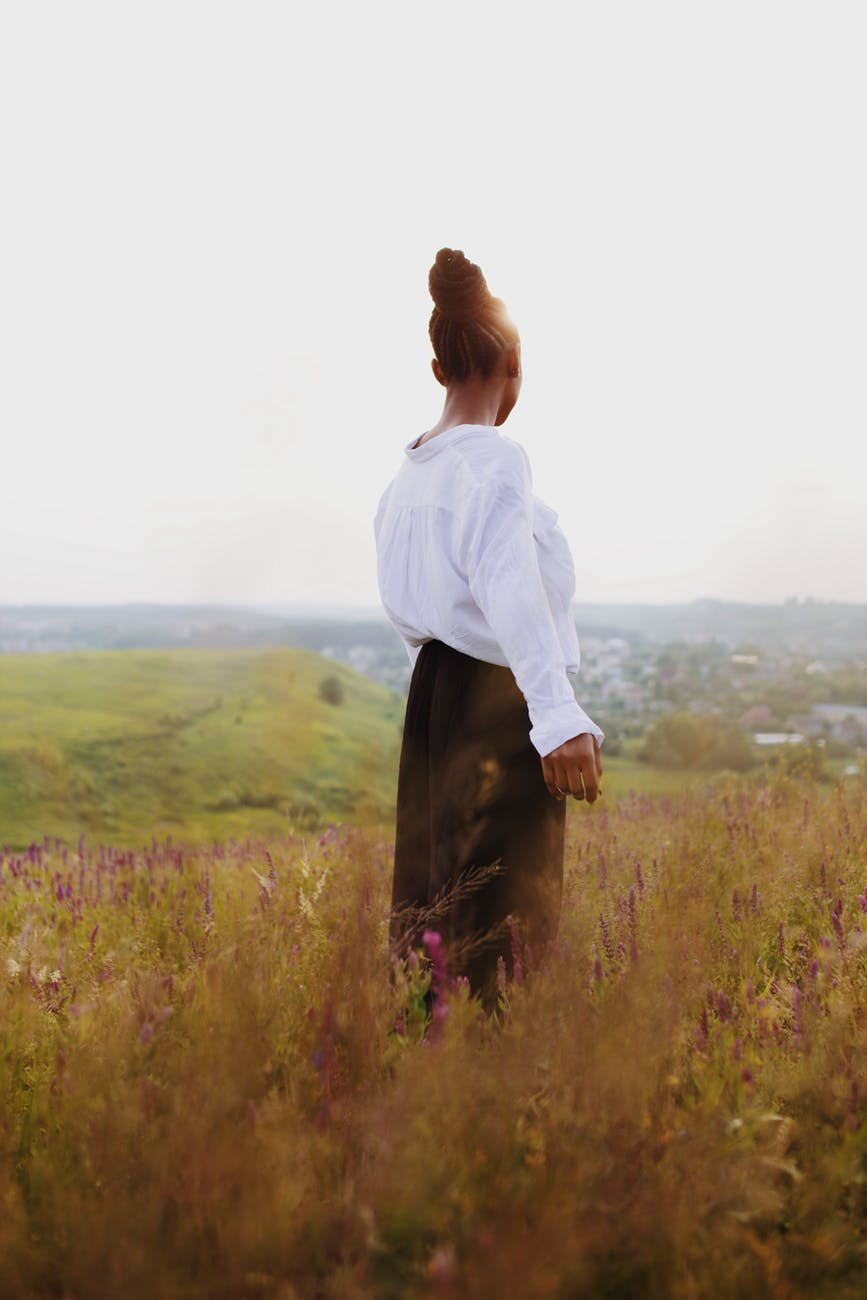 photo of woman standing on field