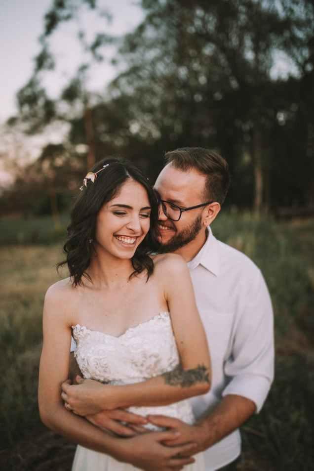 photo of man embracing a woman